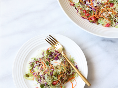 2059Recipe: Shaved Brussels Sprout Slaw with Sesame Ginger Dressing, Pumpkin Seeds and Pomegranate